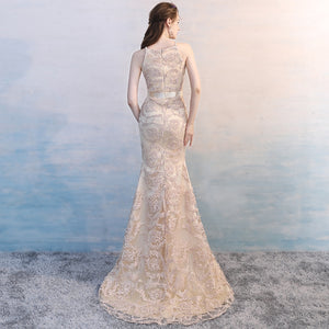 The Valia Tisha Mermaid Halter Champagne Gown