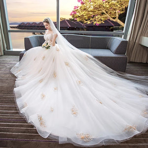 The Leila Bridal Off Shoulder Floral White Gown - WeddingConfetti