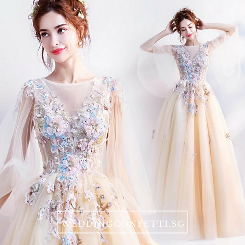 The Gregery Light Yellow 3D floral Flare Sleeves Gown - WeddingConfetti
