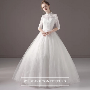 The Tesslia Bridal Long Sleeves Lace Gown - WeddingConfetti