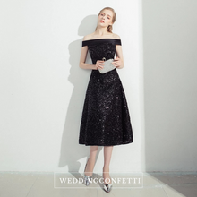 Load image into Gallery viewer, The Prenelia Off Shoulder Black Dress - WeddingConfetti