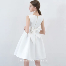 Load image into Gallery viewer, The Amelia Bow White / Black Sleeveless Dress (Available in 2 colours) - WeddingConfetti