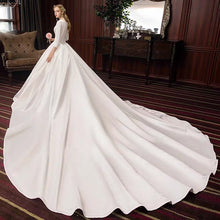 Load image into Gallery viewer, The Pristine Wedding Bridal Satin Long Sleeves Gown - WeddingConfetti