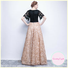 Load image into Gallery viewer, The Charlize Floral Lace Black & Gold Long Sleeves Gown - WeddingConfetti