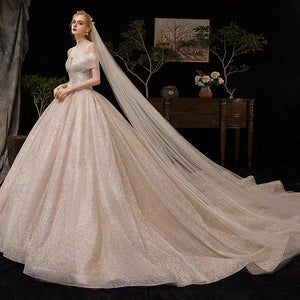 The Fenelee Wedding Bridal Off Shoulder Champagne Gown - WeddingConfetti