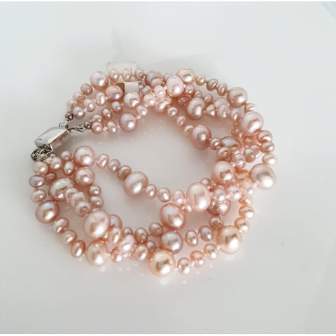 Pink pearl 4 row bracelet with sterling silver clip.
