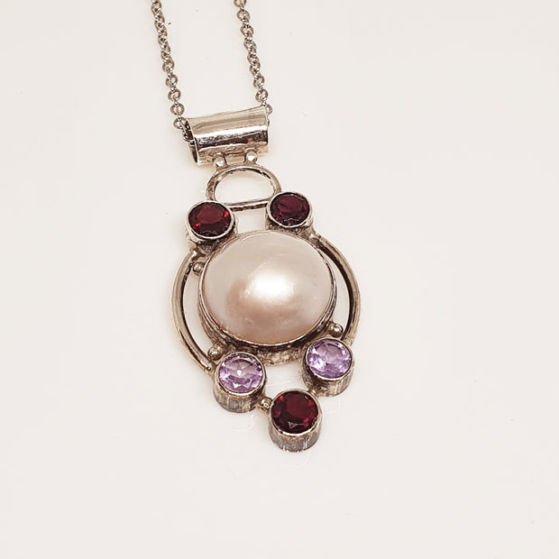 Sterling silver pearl and gem pendant