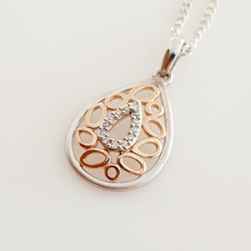 9ct white gold & rose gold Diamond pendant.