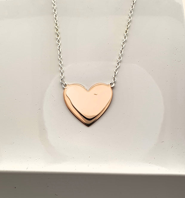 Sterling silver and rose gold plated heart necklace.