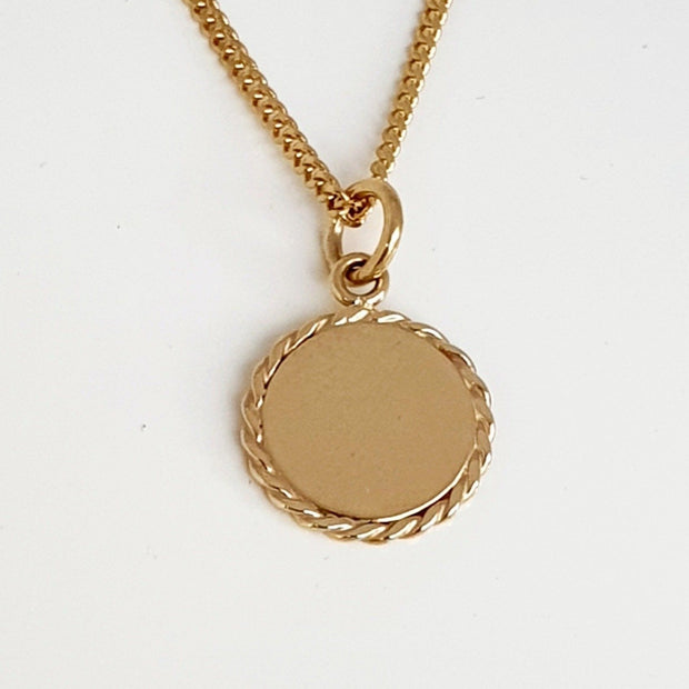 9ct yellow gold disc pendant.