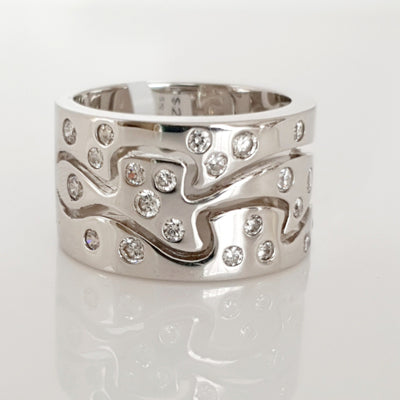 Sterling silver wide CZ ring.