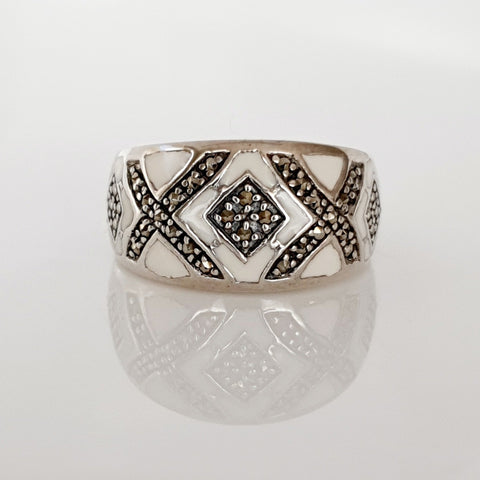 Sterling silver marcasite & white enamel ring.