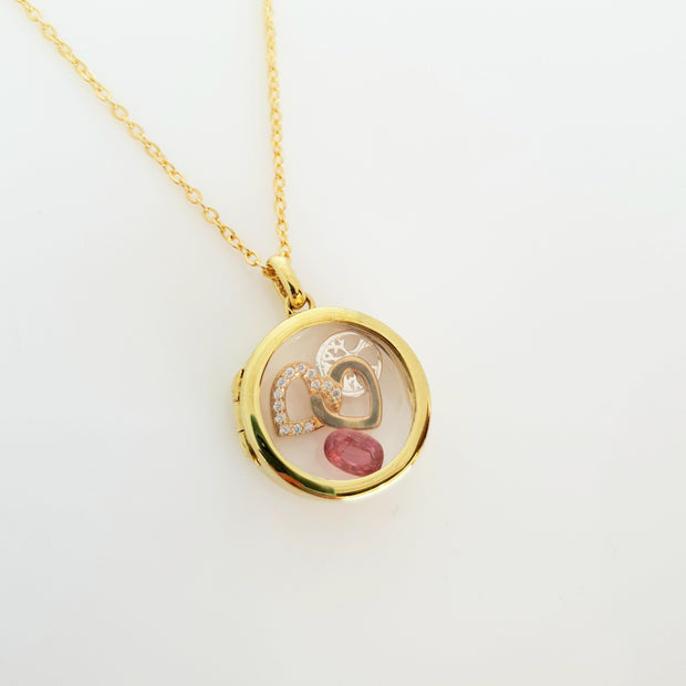 Sterling silver gold plated 20mm  locket.
