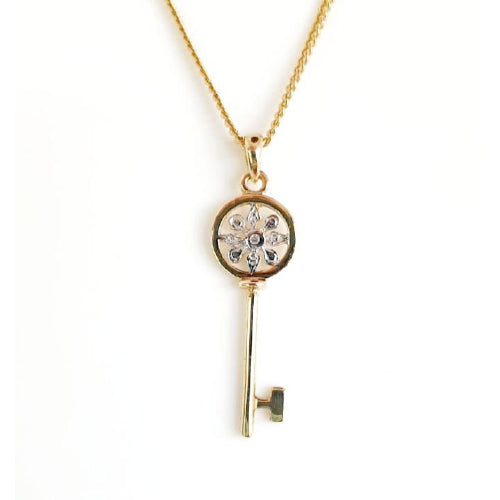 9ct gold diamond set key pendant