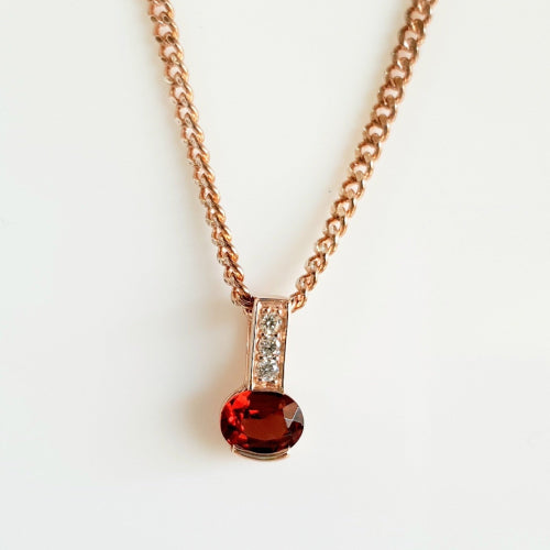 9ct rose gold Garnet and Diamond pendant.
