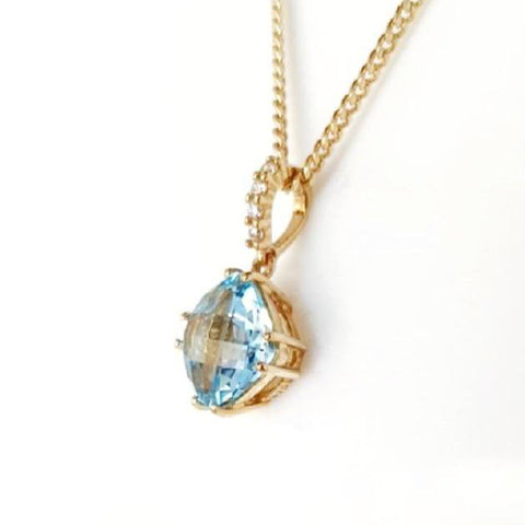 9ct blue topaz and diamond pendant