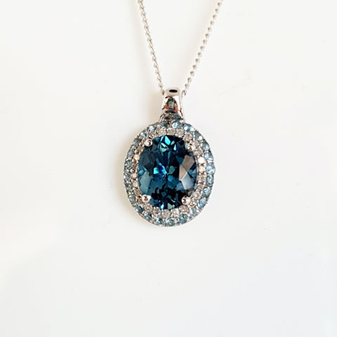 9ct white gold Topaz and Diamond pendant.
