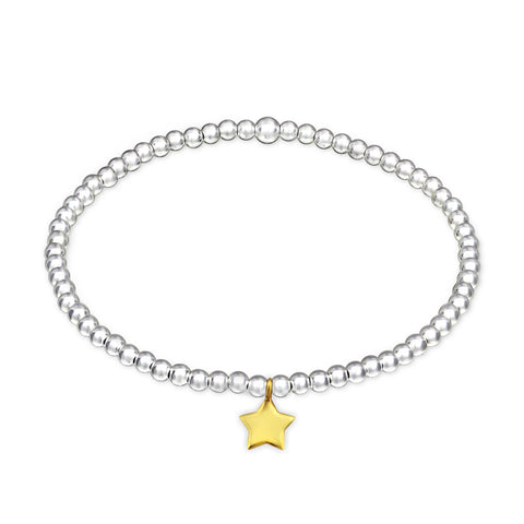 Ball stretch bracelet with gold plated star charm.