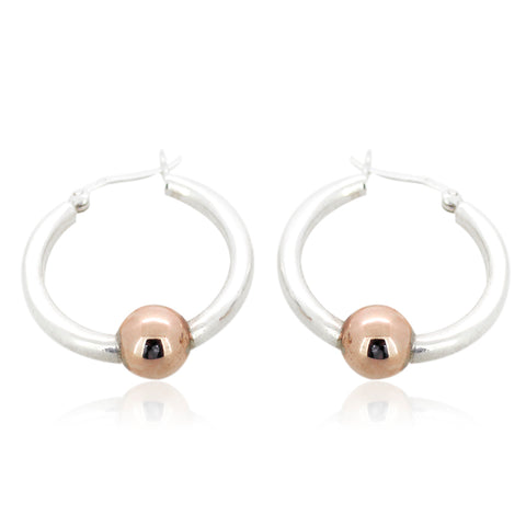 Sterling silver ball hoop earrings.