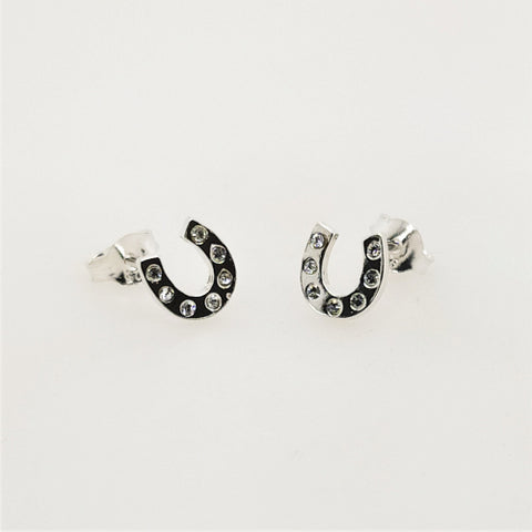Sterling silver CZ horseshoe earrings.