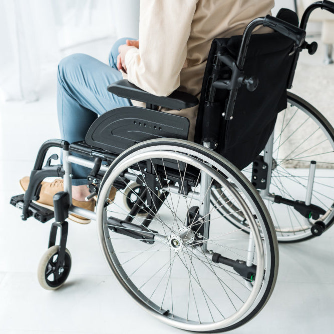 man sitting in modern wheelchair