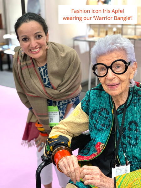 Iris Apfel at Lai booth at NY NOW 2019. Seen here wearing our Channapatna handcrafted lacquered wooden warrior dramatic bangle