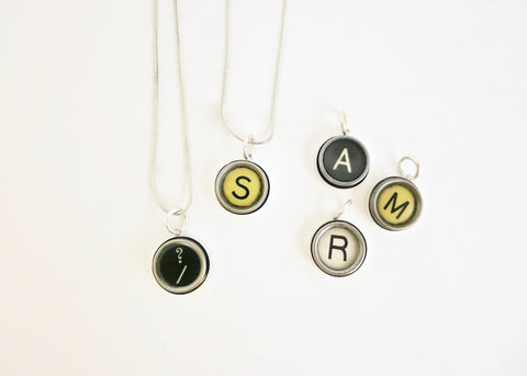 Vintage French typewriter key pendant on a silver snake chain