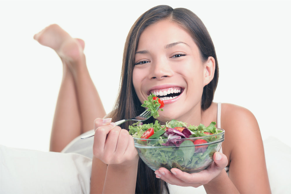 The most famous stock photo model eating a salad