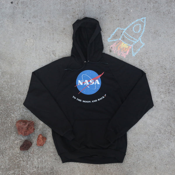 Black NASA pullover hoodie with To the Moon and Back on it with a chalked rocket and red rocks next to it