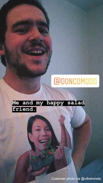 A customer (actor and Vine star Vilhelm Neto) wearing the Smiling woman eating a healthy vegetable salad T-shirt