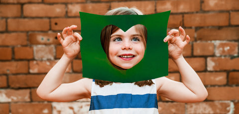 child face in the heart cut frame