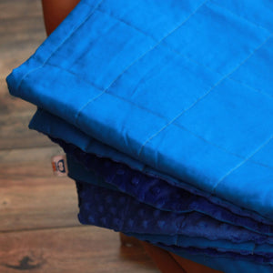 BLUE COTTON MINKY WEIGHTED BLANKET WITH COBALT MINKY BACKING ON THE ARMCHAIR