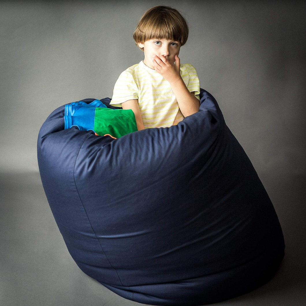 boy sitting in the SENSORY TUNNEL made by sensory owl
