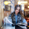 Keenan Constance photo of woman reading newspaper, on Unsplash