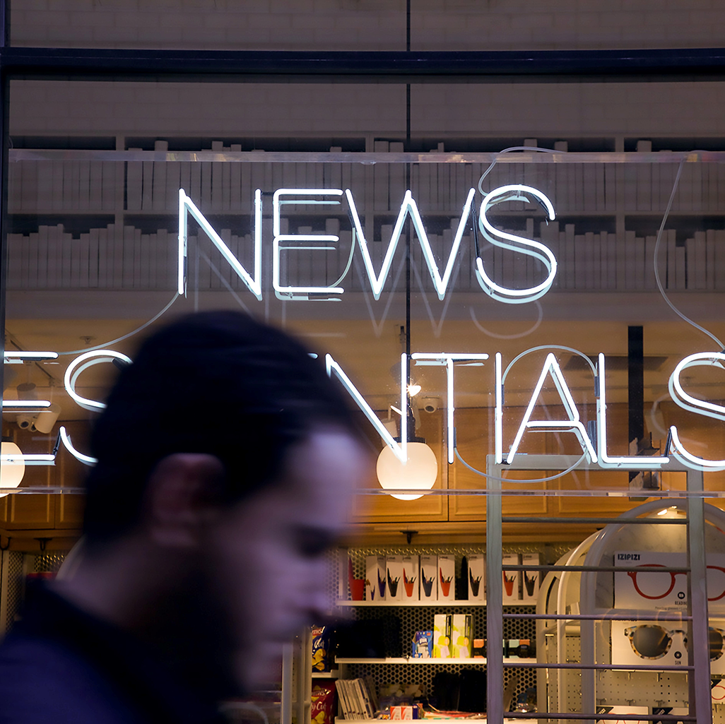 Man in front of News Stand, photo by Lora Ohanessian on Unsplash