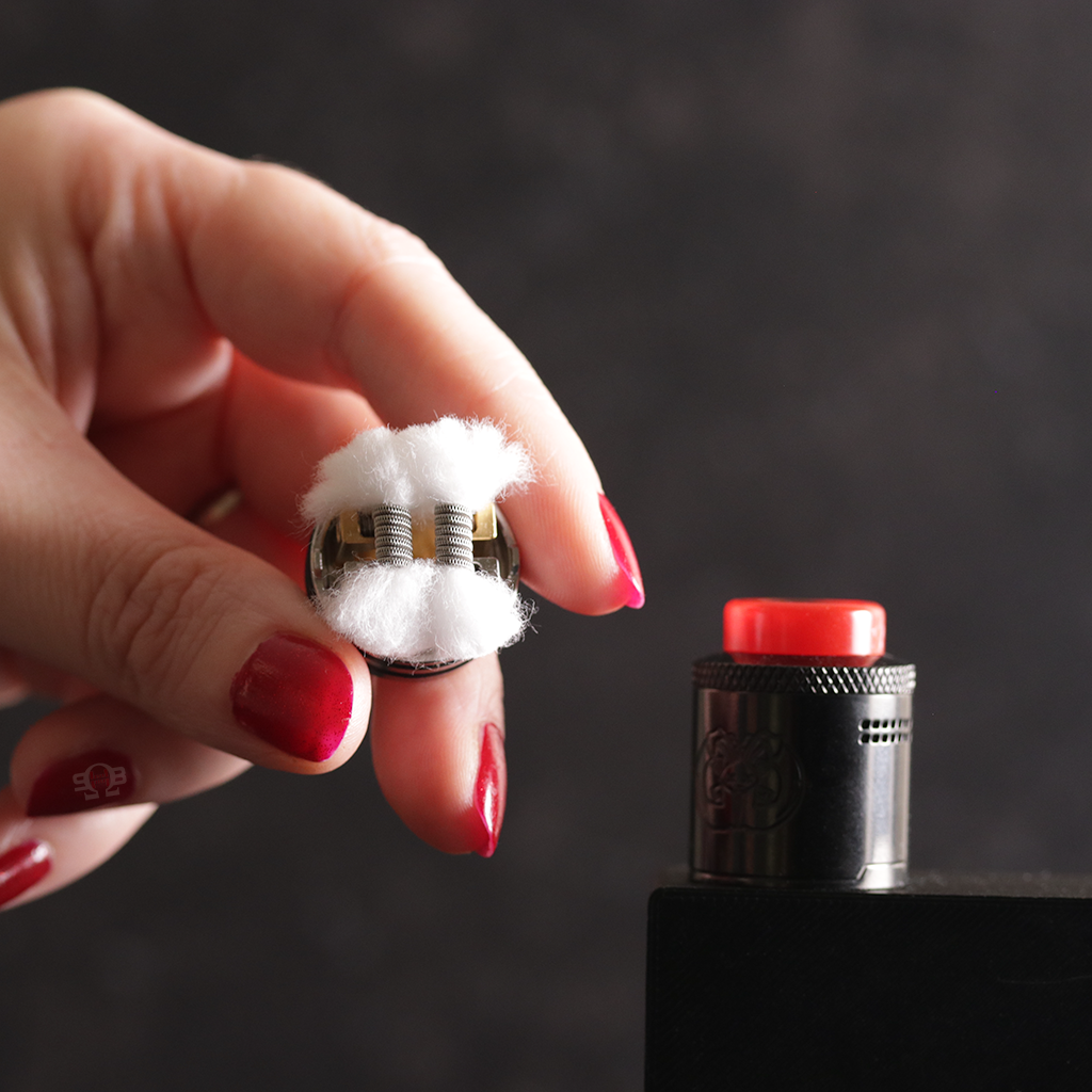 Drop Dead RDA loaded with coils and wicked.