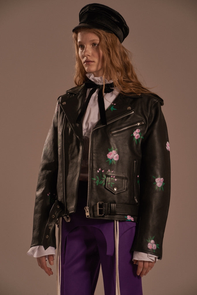 Leather biker jacket with «Dream» inscription