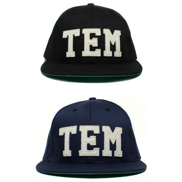 TEM (THE ESSENTIAL MAN) BALL CAP