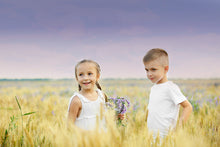 Kids in wheat field with sunset in background Photoshop Actions