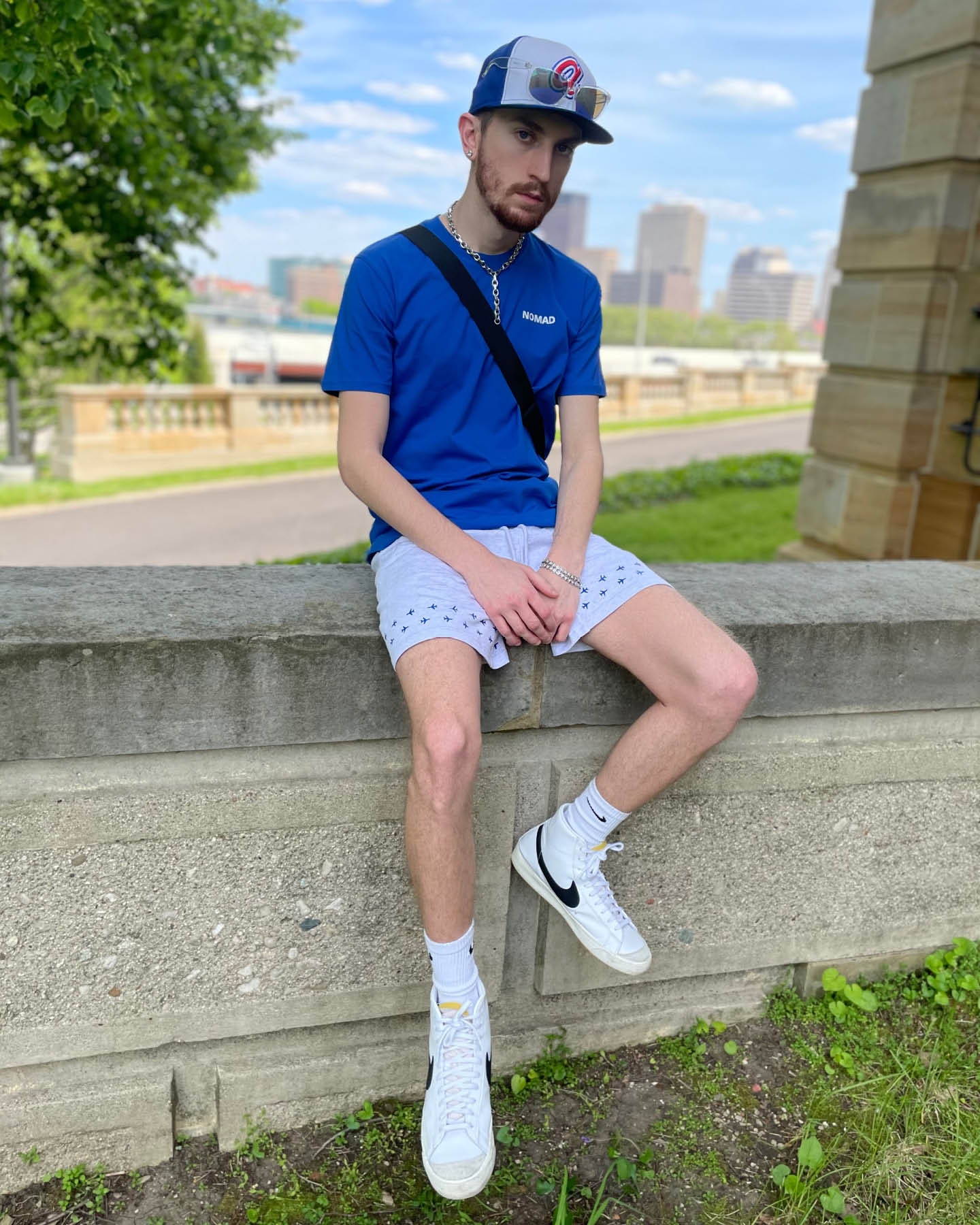 Aaron Seelig wearing The World Is Yours shirt and Runway Shorts from the Nomad Creative Works Spring 2021 collection at the Dayton Art Institute, Sitting View.