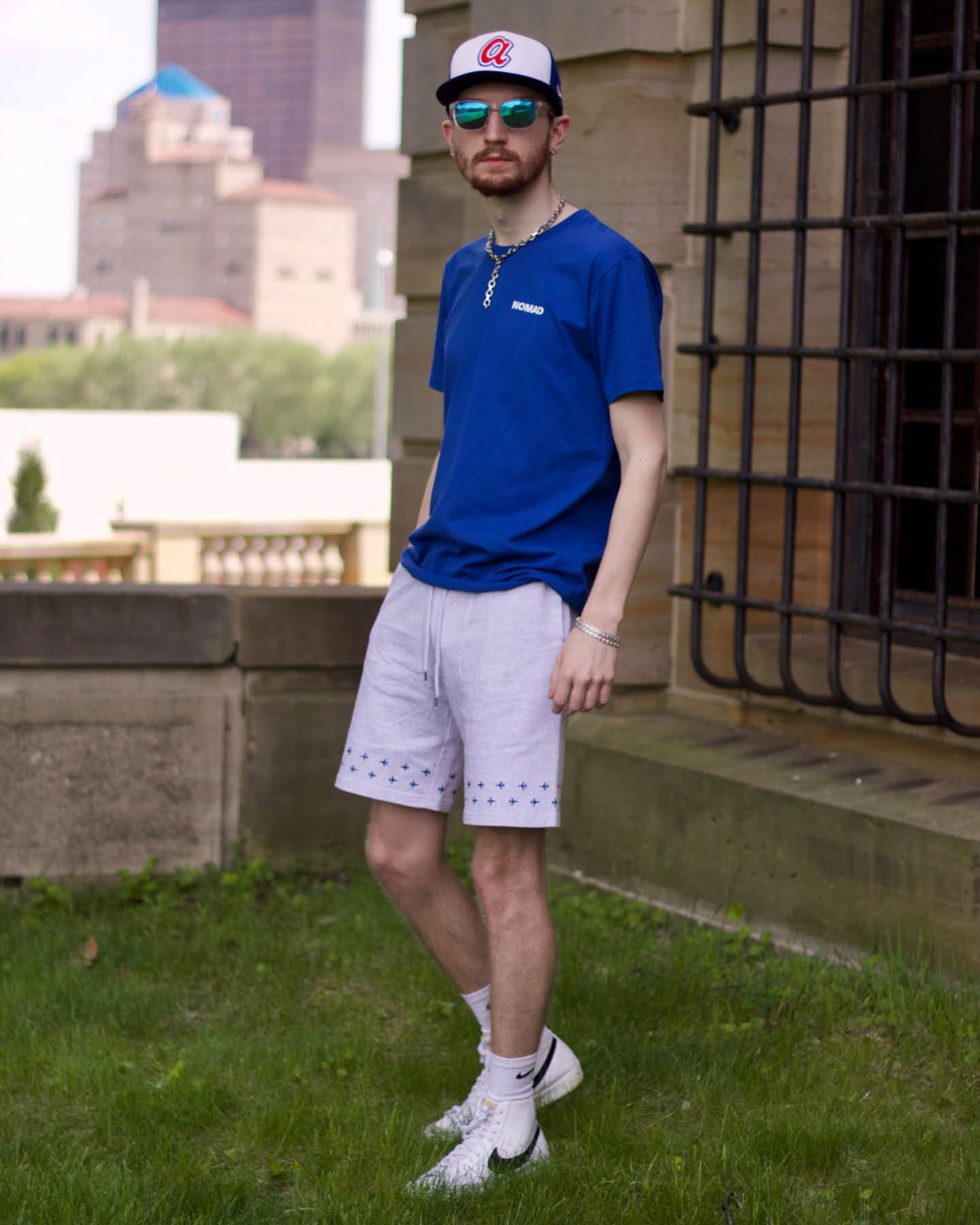 Aaron Seelig wearing The World Is Yours shirt from the Nomad Creative Works Spring 2021 collection at the Dayton Art Institute, Walking sunset View.