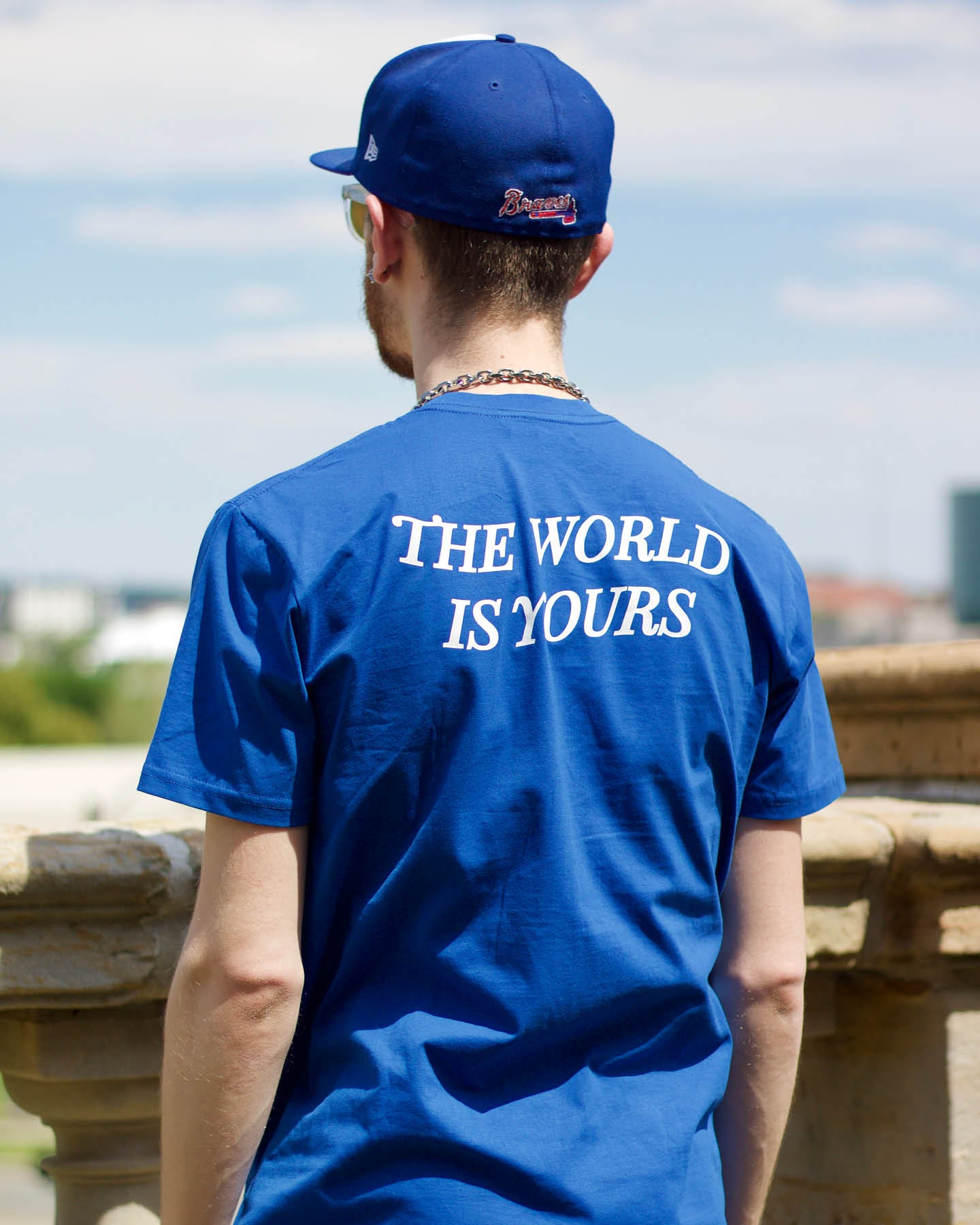 Aaron Seelig wearing The World Is Yours shirt from the Nomad Creative Works Spring 2021 collection at the Dayton Art Institute, Back View.