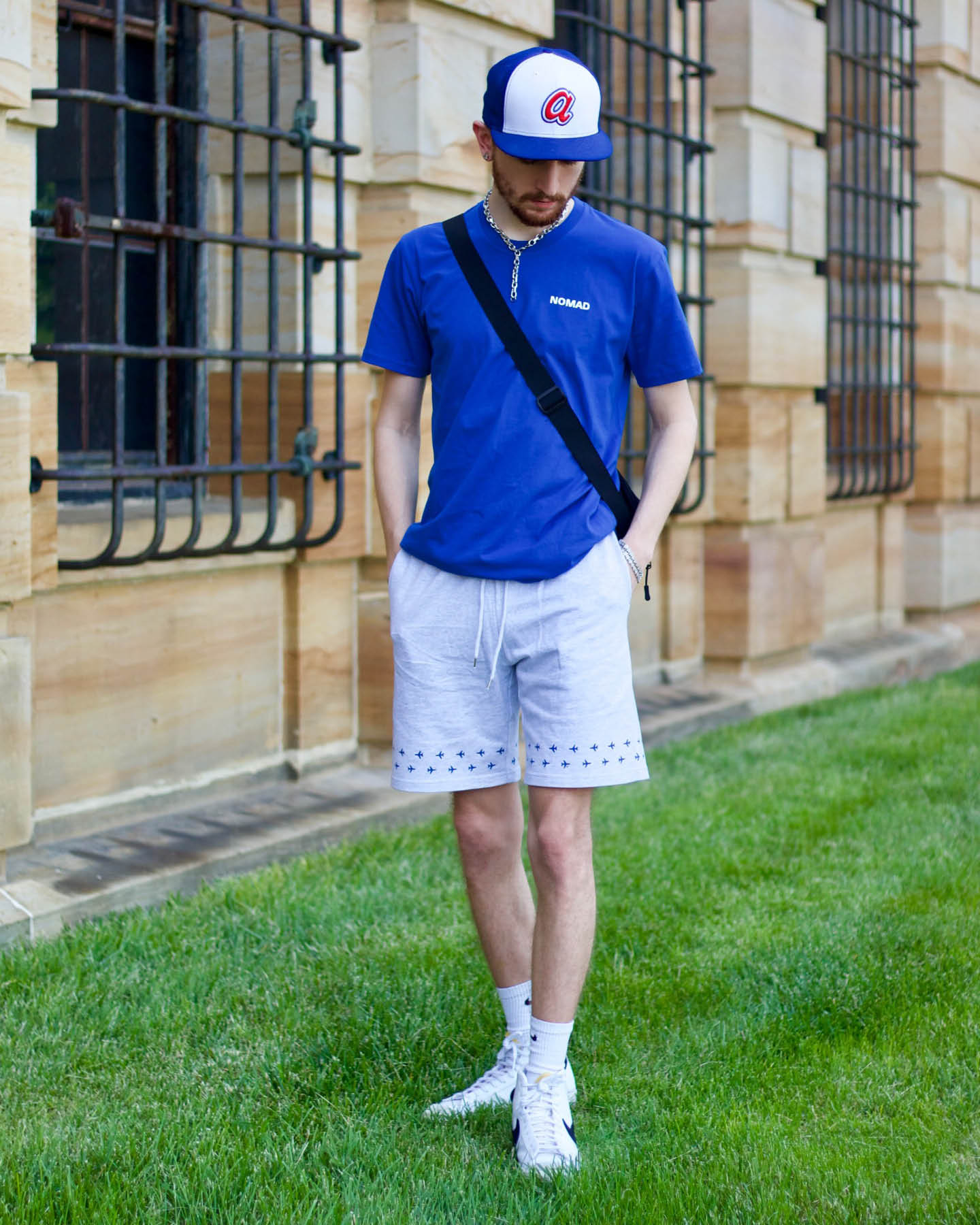 Aaron Seelig wearing The World Is Yours shirt & Runway Shorts from the Nomad Creative Works Spring 2021 collection at the Dayton Art Institute, Front View.