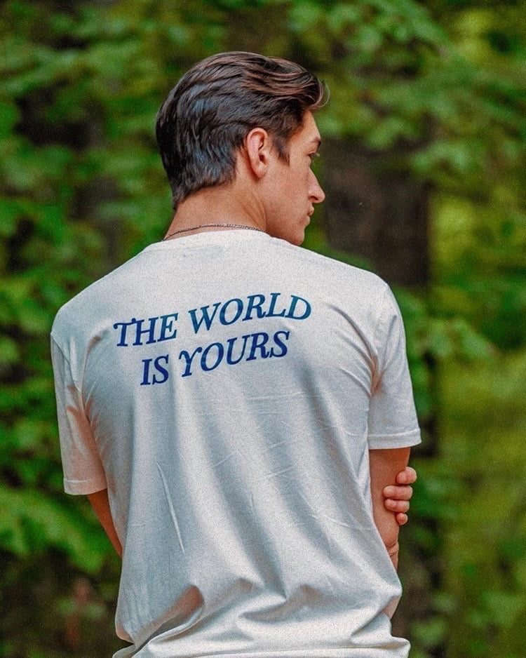 Diego Pulido in The World Is Yours Shirt, shot in Lake Norman, South Carolina. Back View.