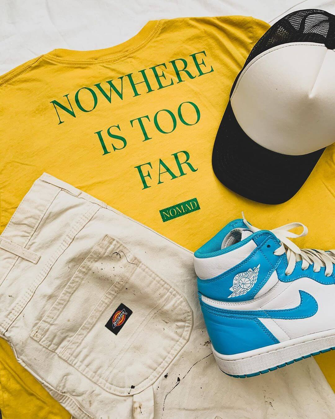 Noelly West wearing the Nomad Creative Works Nowhere Is Too Far Shirt in Lemon with Emerald Printing
