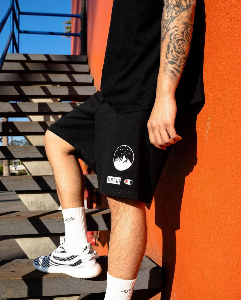 Retro Mike in Nomad Creative Works wearing the Mountain Print shorts in black