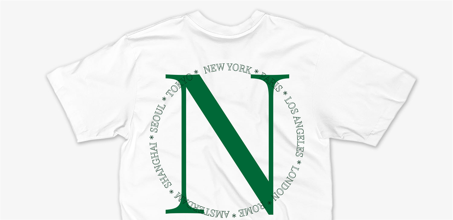 White / Emerald Nomad Worldwide Tee by Nomad Creative Works.