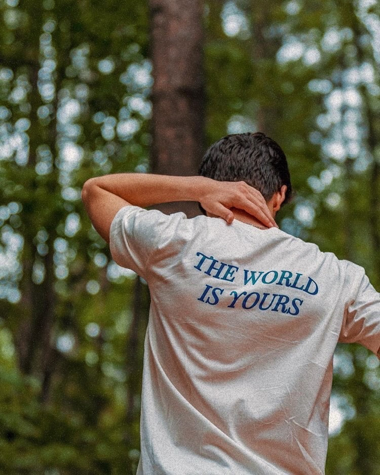 Diego Pulido in The World Is Yours Shirt, shot in Lake Norman, South Carolina. Back View 2.