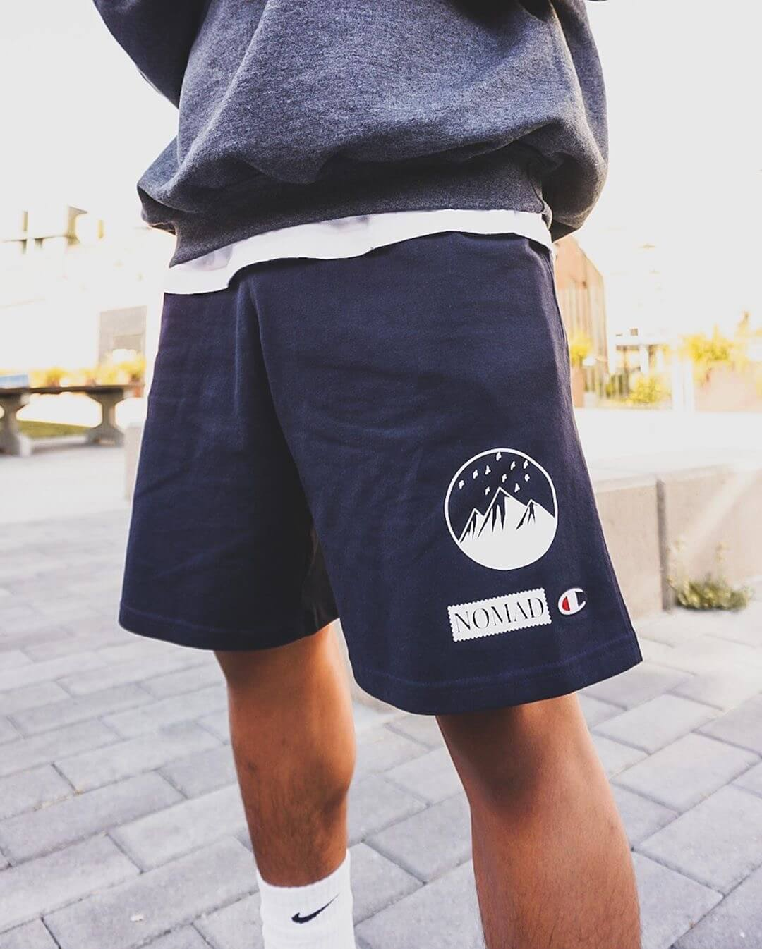 Noelly West wearing the Nomad Creative Works Mountain Print Shorts in Navy with Quartz printing