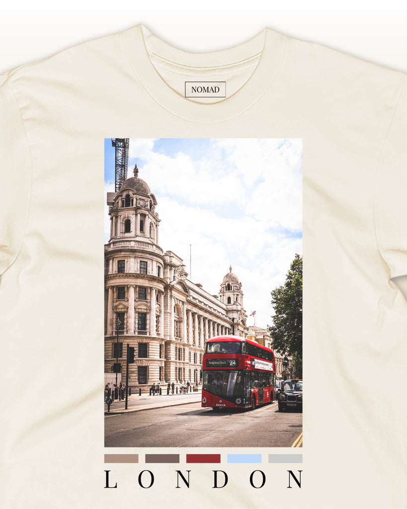The london front print t-shirt by nomad creative works featuring a front print of london bus & the parliament building